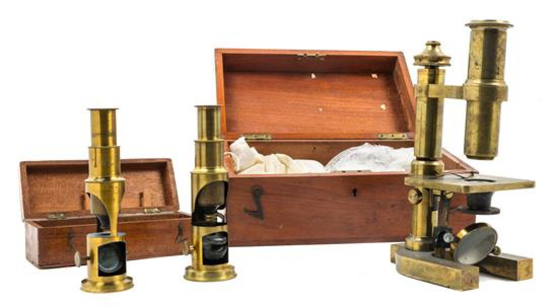 * An English Brass Microscope Height 9 inches.