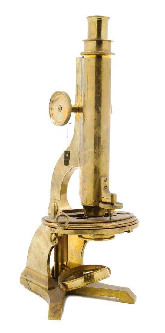 * An English Brass Microscope Height 13 1/2 inches.