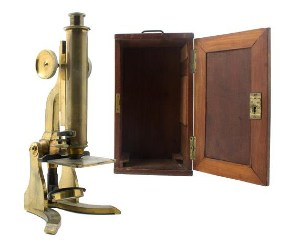 * An English Brass Microscope Height 12 1/2 inches.