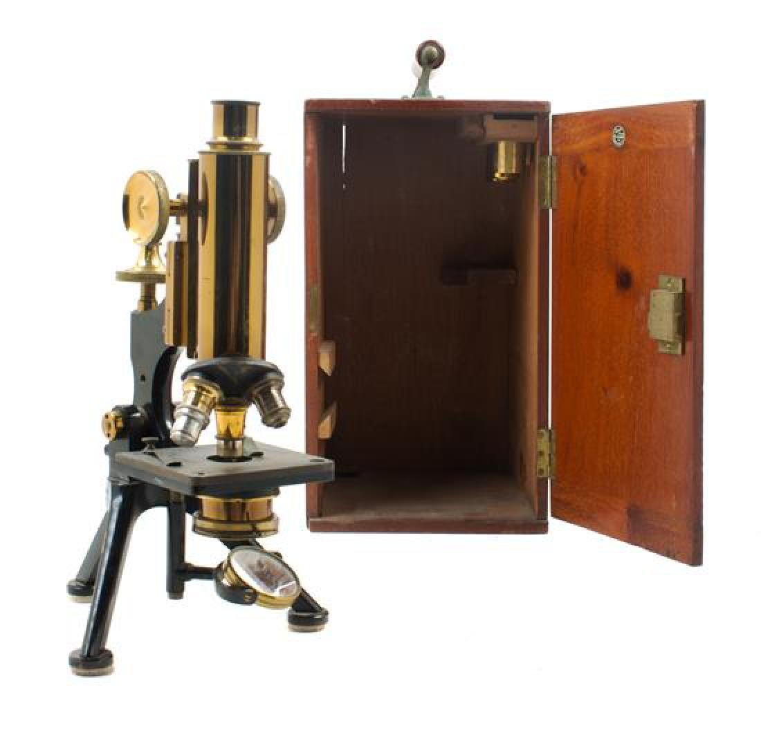 * An English Brass and Black Lacquered Microscope