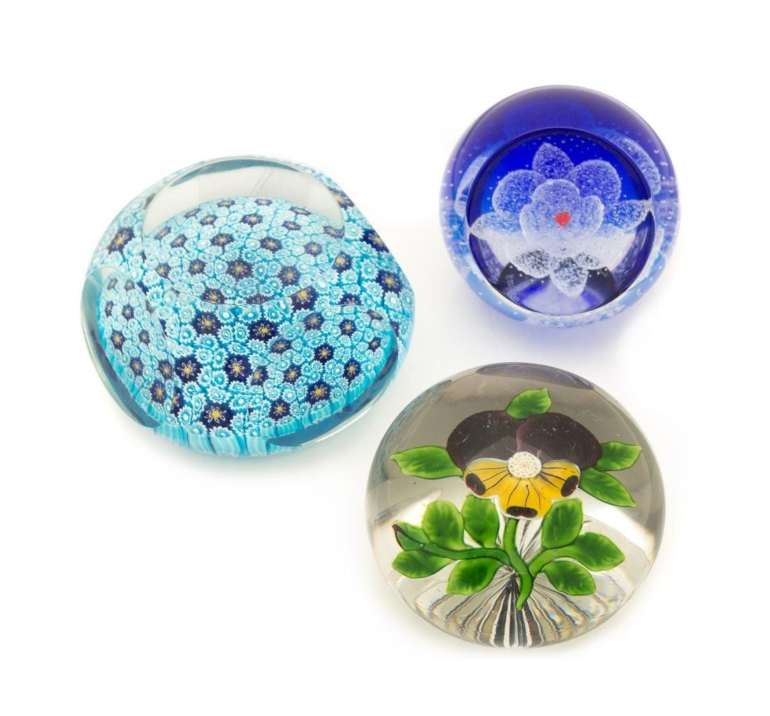 * A Group of Three Glass Paperweights, one marked for