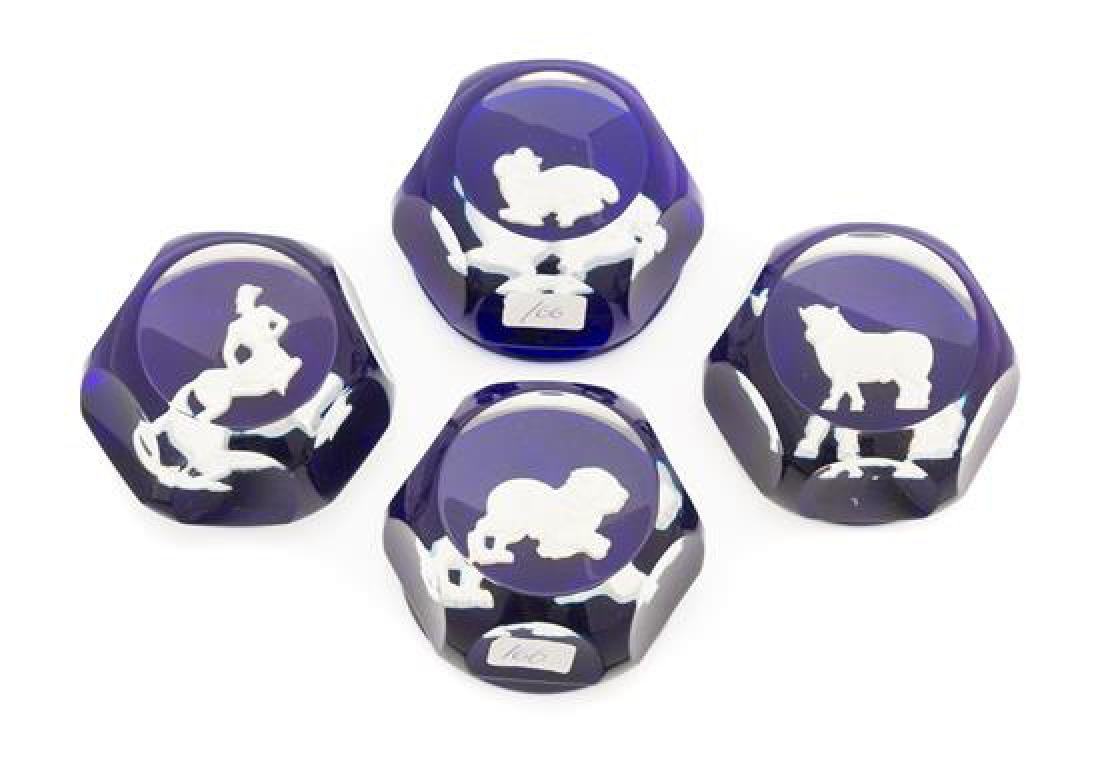 * Baccarat , , four paperweights with zodiac symbols