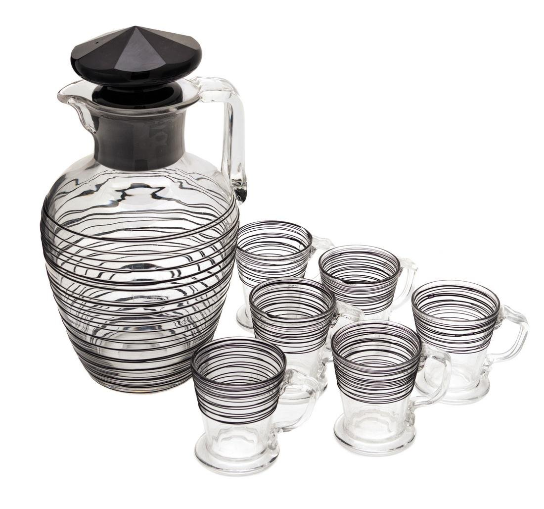 Steuben, , a black threaded-glass water pitcher with 6