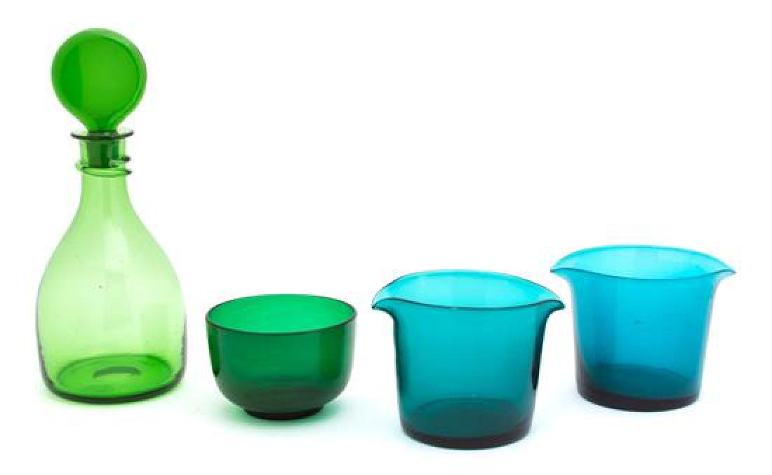 A Group of Four Colored Glass Table Articles Height of
