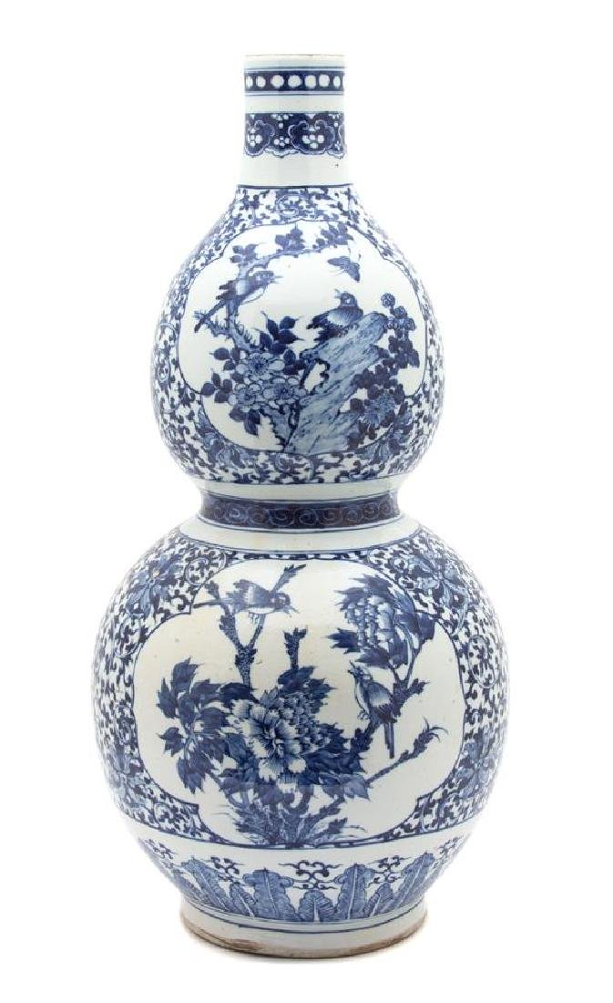 A Chinese Export Blue and White Porcelain Gourd Vase