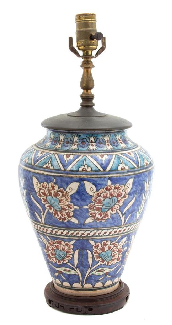 A Persian Glazed Ceramic Vase Vase, height 11 inches.