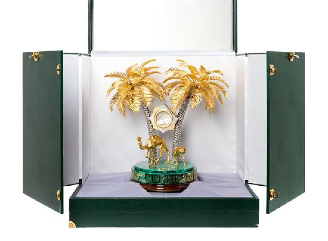 A Gilt Metal and Malachite Veneered Clock