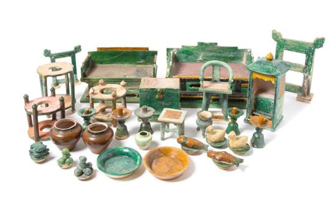 * A Large Chinese Sancai Glazed Pottery Funerary Set