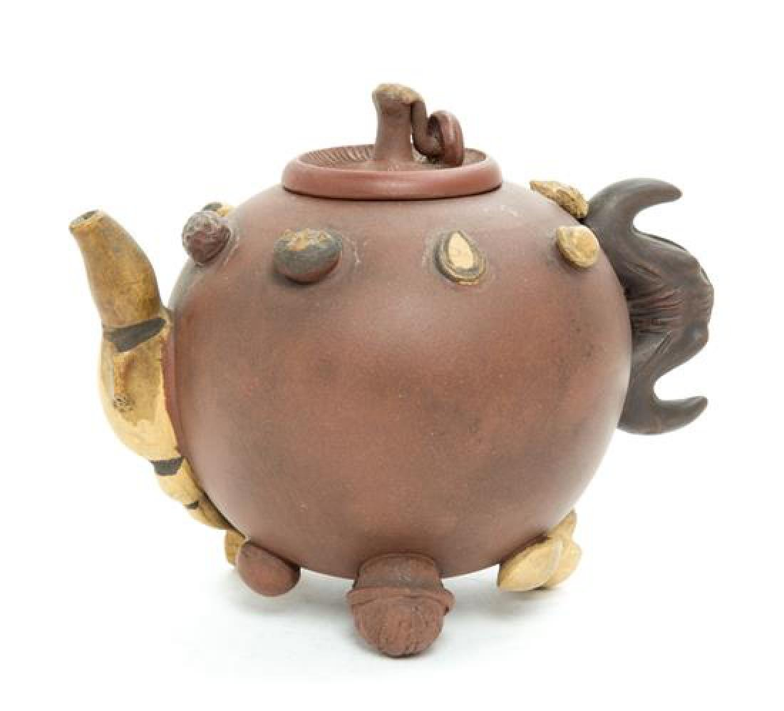 A Chinese Yixing Pottery Teapot Height 5 1/2 inches.