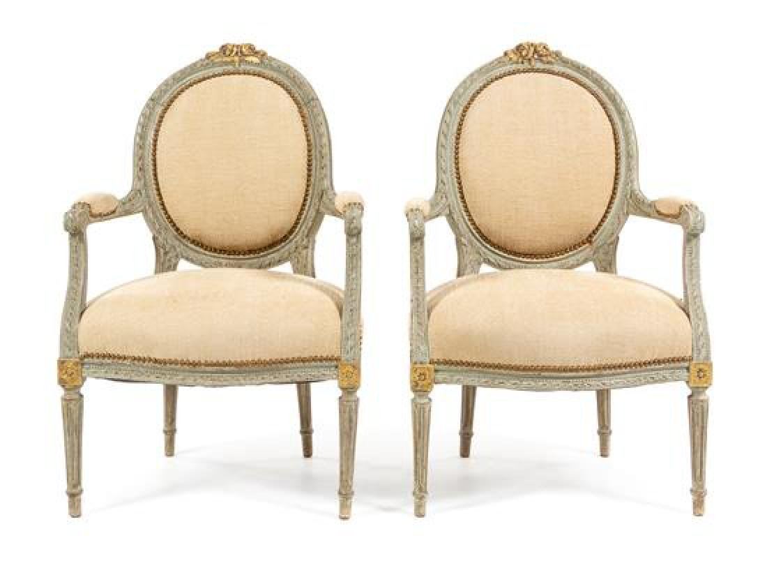 A Pair of Louis XVI Style Painted and Parcel Gilt