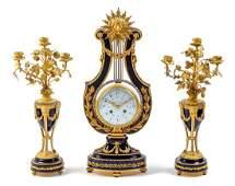 A French Gilt Bronze and Porcelain Clock Garniture