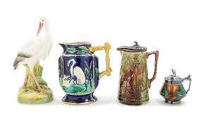 A Group of Four Majolica Table Articles Height of
