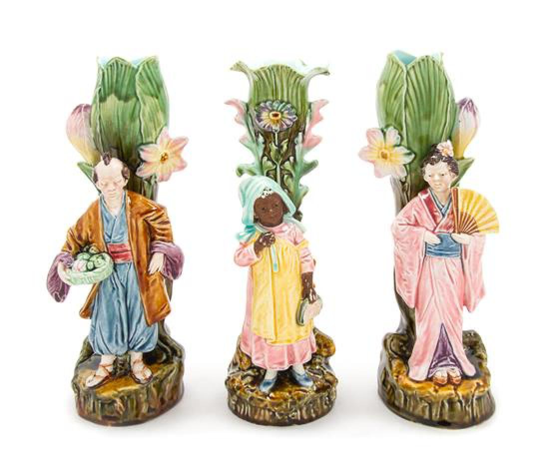 * Three Majolica Figural Spill Vases Height of each 11
