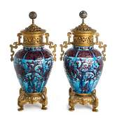 * A Pair of Chinese Gilt Bronze Mounted Porcelain Fahua