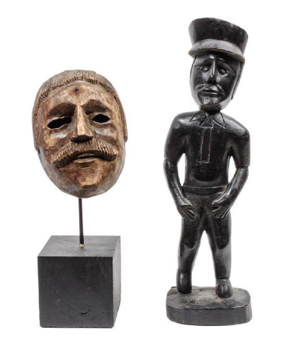 Two Carved Wood Figures of Men Height of tallest 14 1/2