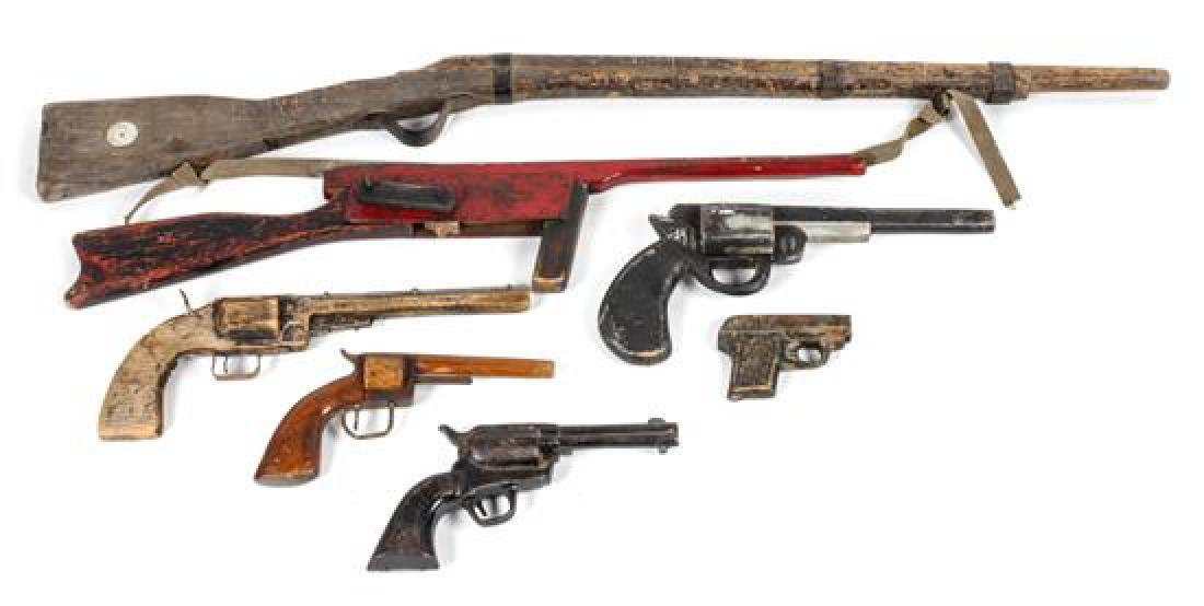 Seven Decorative and Toy Guns Length of largest 40 1/2