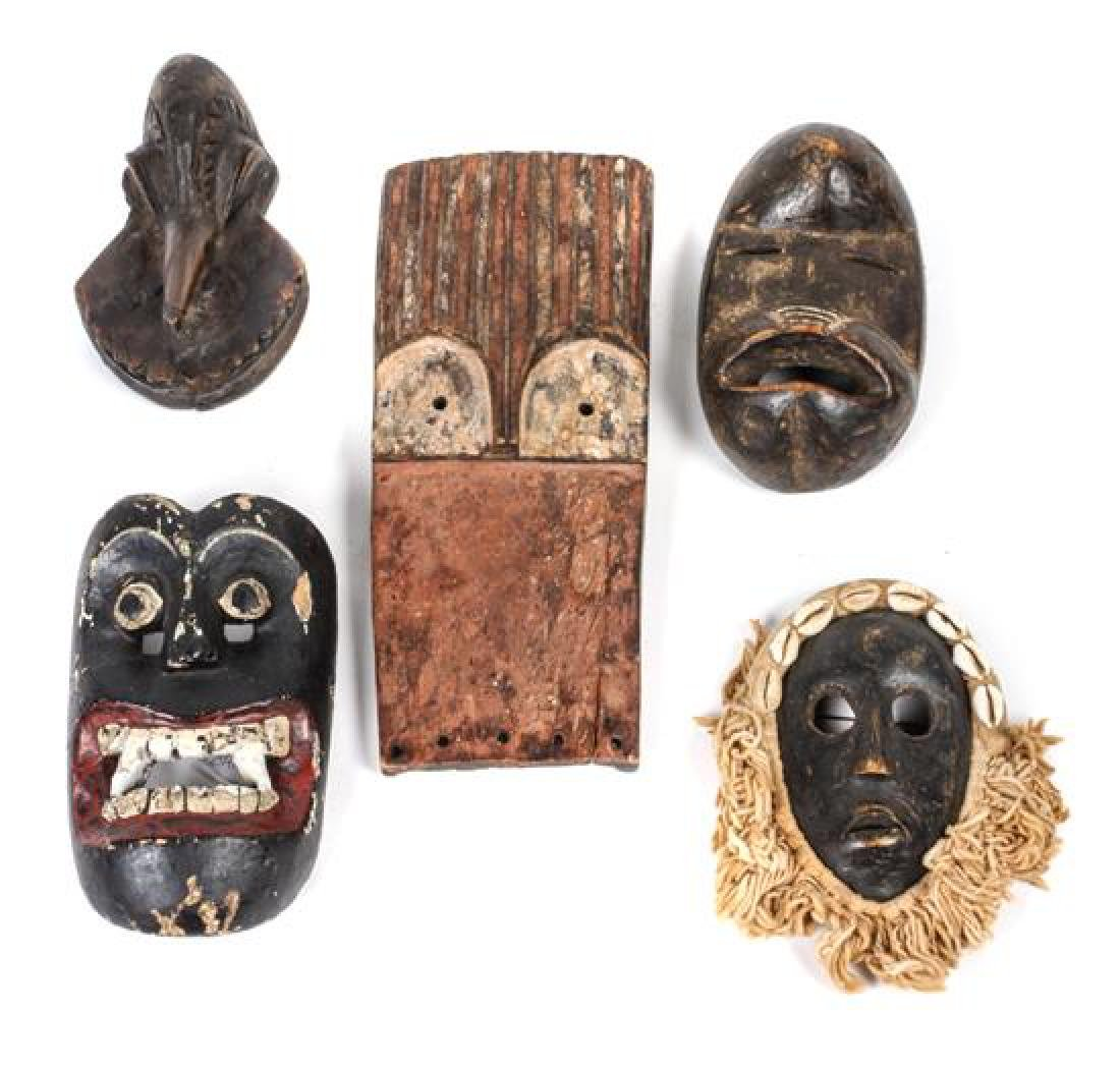 Five Decorative Carved Wood Masks Height of largest 10