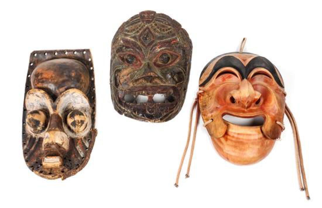 Three Large Decorative Masks Height of largest 16 1/2