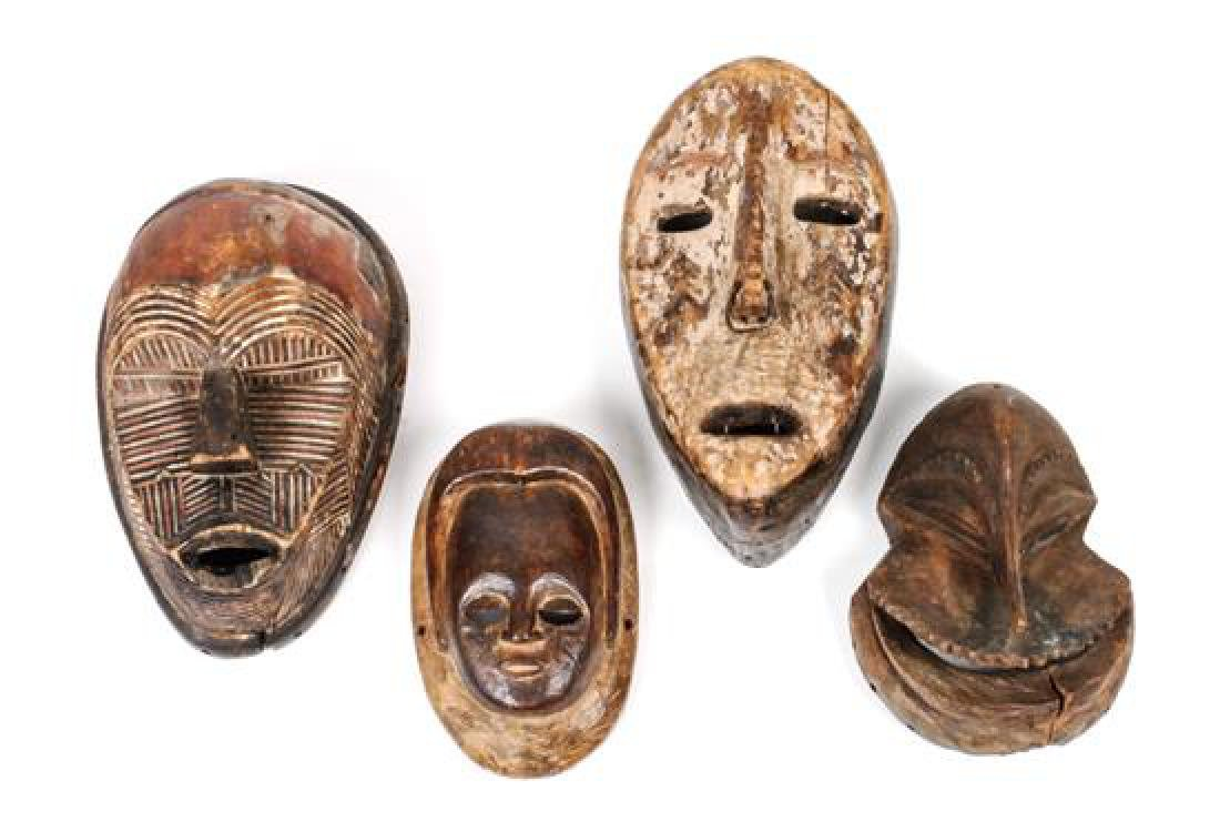 Four African Carved Wood Masks Height of largest 10