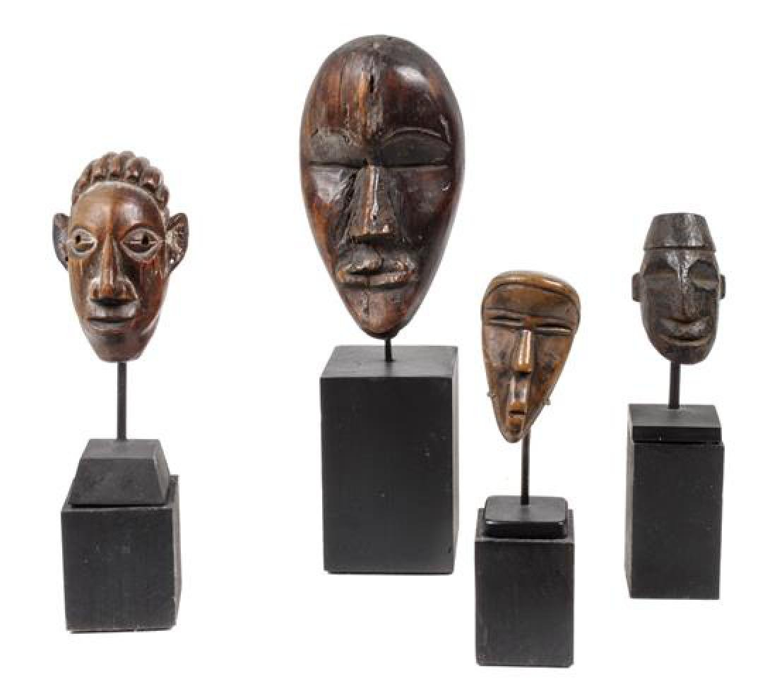 Eight Miniature Carved Wood African Masks Height of