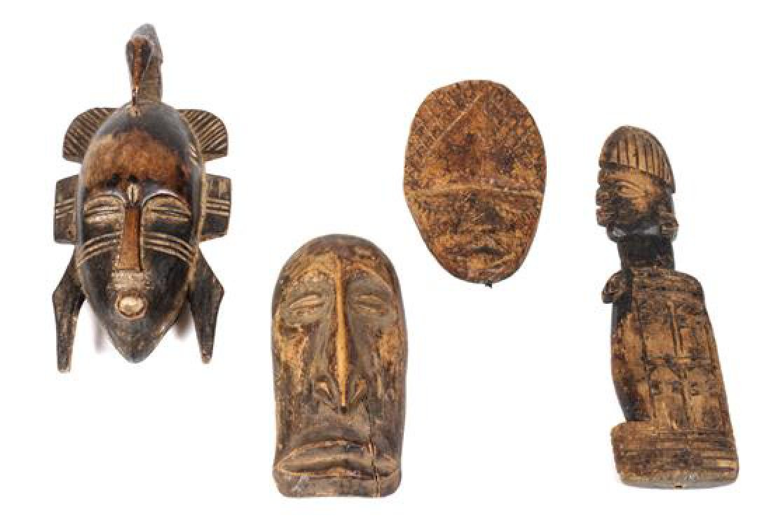 Eight Miniature Carved Wood African Masks Height of - 2