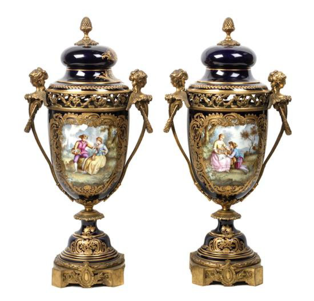 Pair of Sevres Style Gilt Bronze Mounted Porcelain Urns