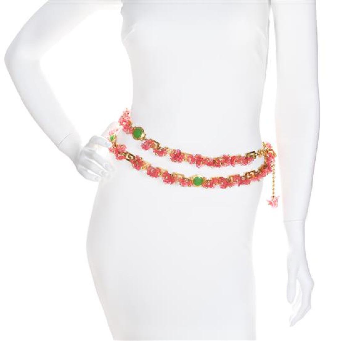 A Gianni Versace Pink Floral and Greco Link Belt,