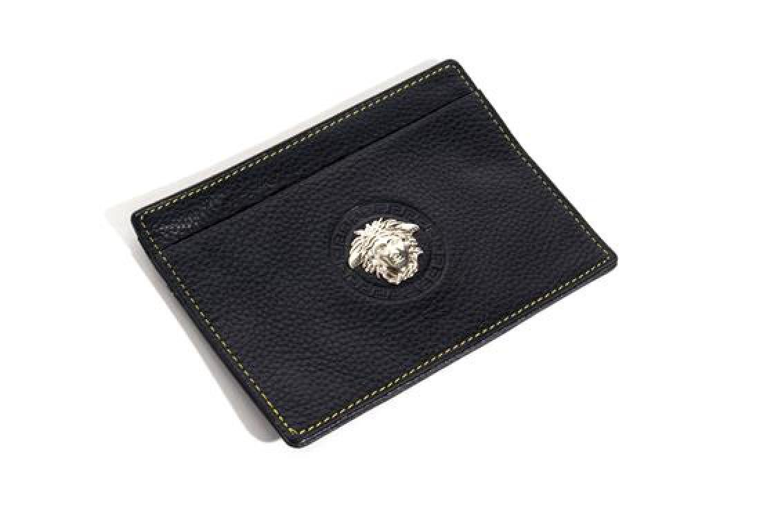 A Gianni Versace Black Embossed Leather Wallet,