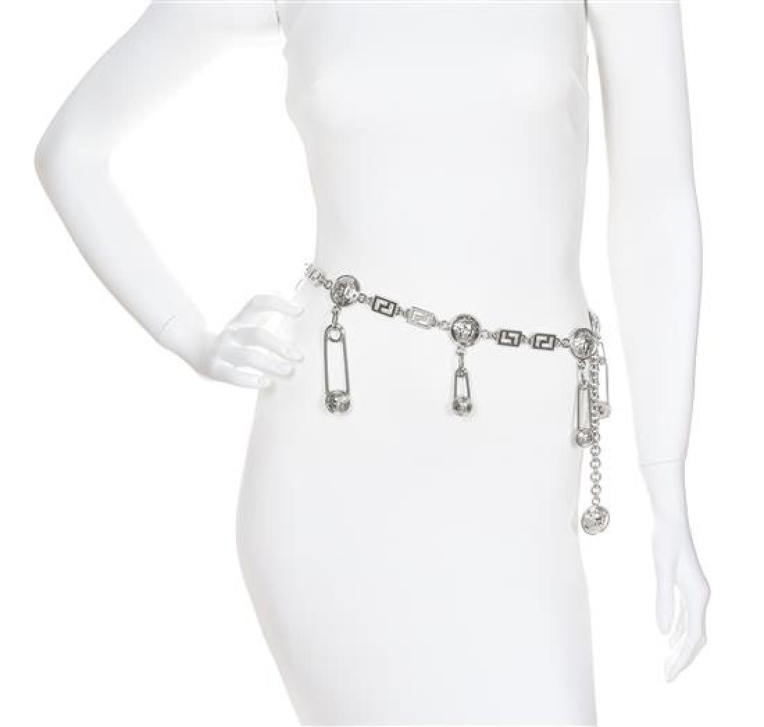 A Gianni Versace Safety Pin and Greco Link Belt,