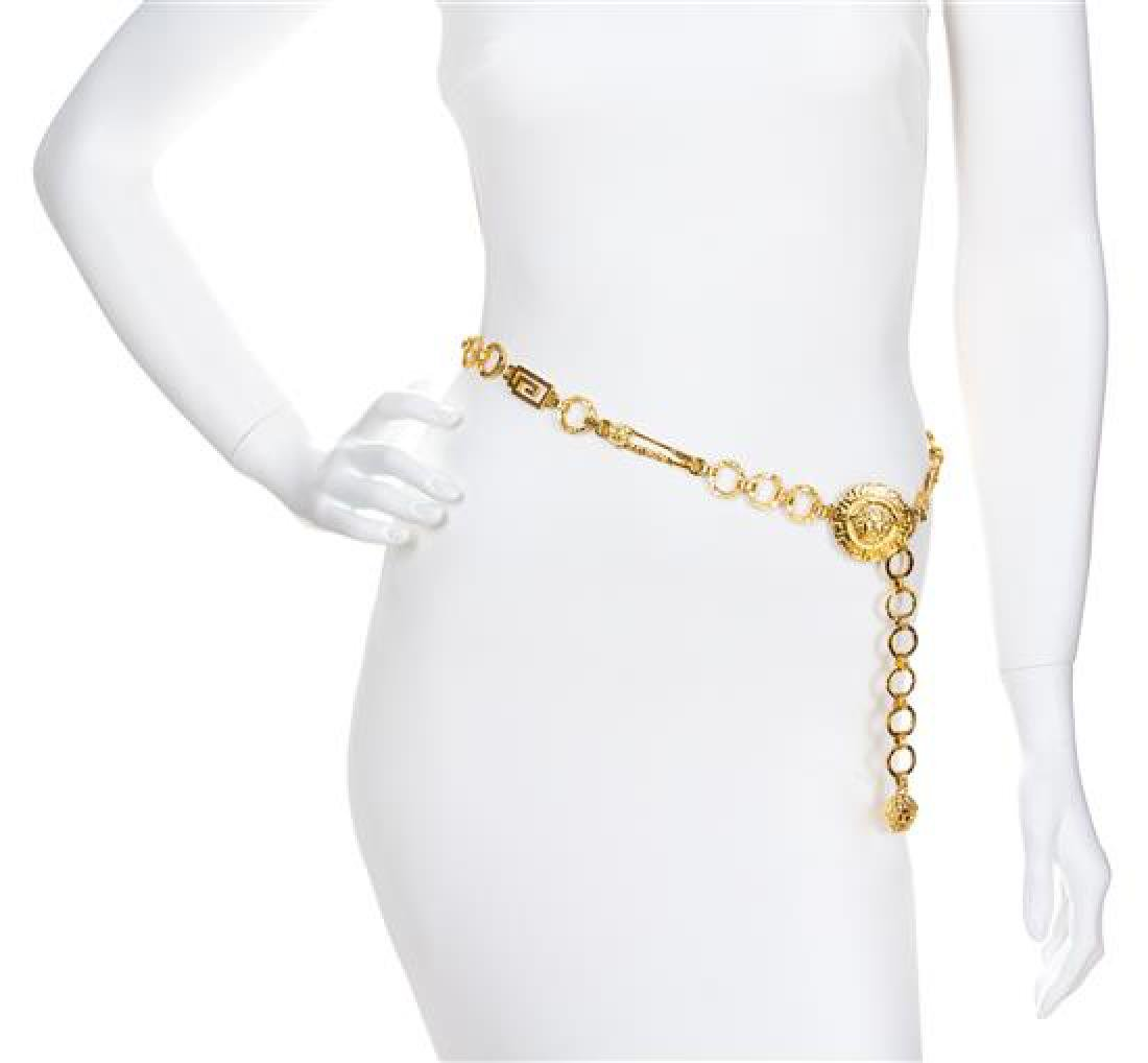"A Gianni Versace Safety Pin Link Belt, 35"" x .75""."