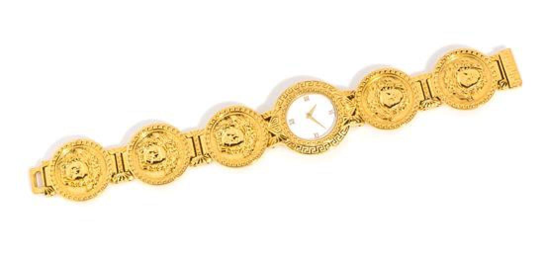 """A Gianni Versace Medusa Disc Link Watch, 7.5"""" X 1.25""""."""