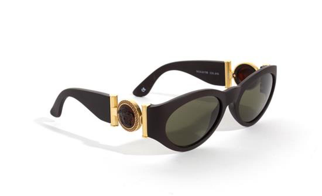 A Pair of Gianni Versace Brown Sunglasses,