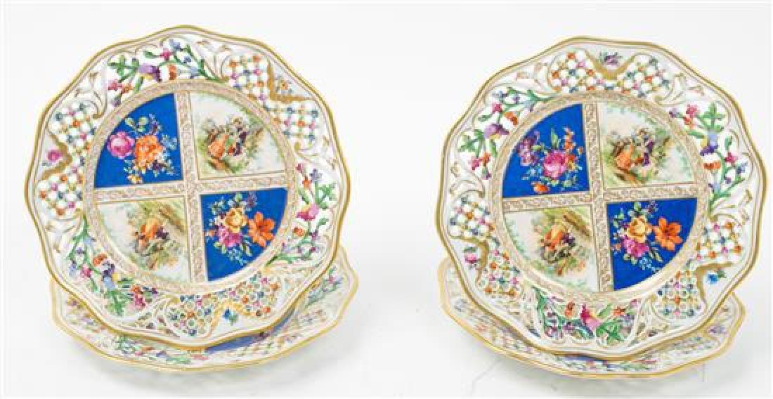 A Set of Seventeen Pierced Dresden Porcelain Plates