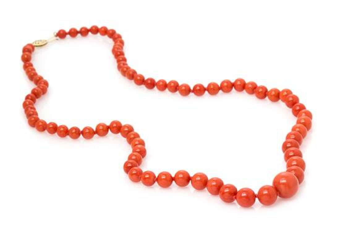 A Graduated Coral Bead Necklace,