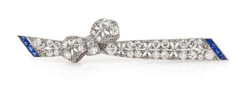 An Art Deco Platinum Diamond and Sapphire Bow Bar