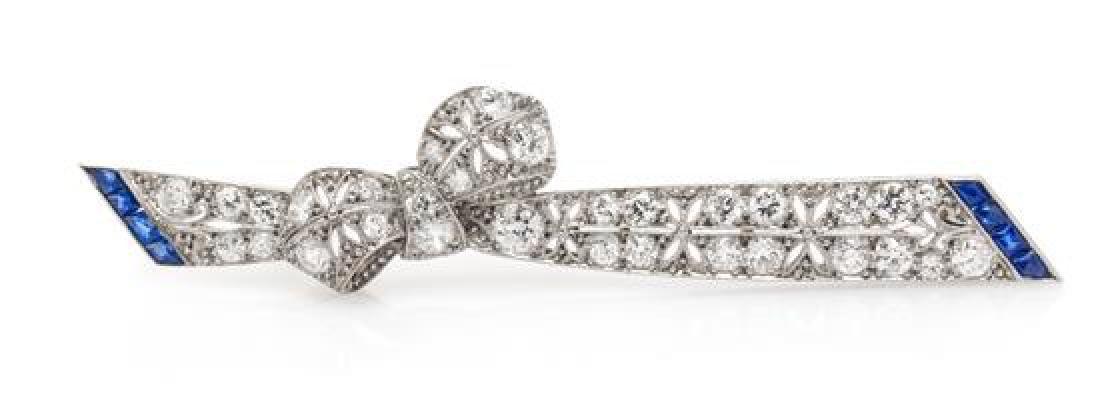 An Art Deco Platinum, Diamond and Sapphire Bow Bar