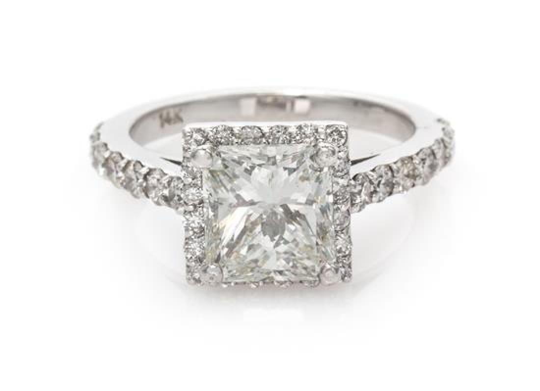 A 14 Karat White Gold and Diamond Ring, 3.35 dwts.