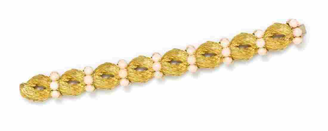 An 18 Karat Yellow Gold and Angel Skin Coral Bracelet,