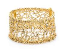 A High Karat Yellow Gold and Diamond Bangle Bracelet