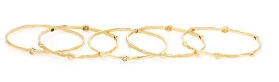 A Collection of 18 Karat Yellow Gold and Diamond Bangle