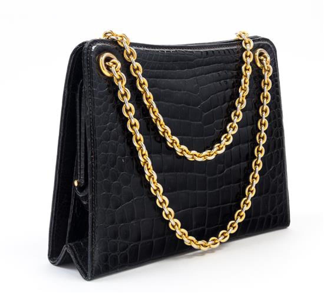"A Gucci Black Crocodile Handbag, 9.5"" x 7.5"" x 2.5""; - 2"