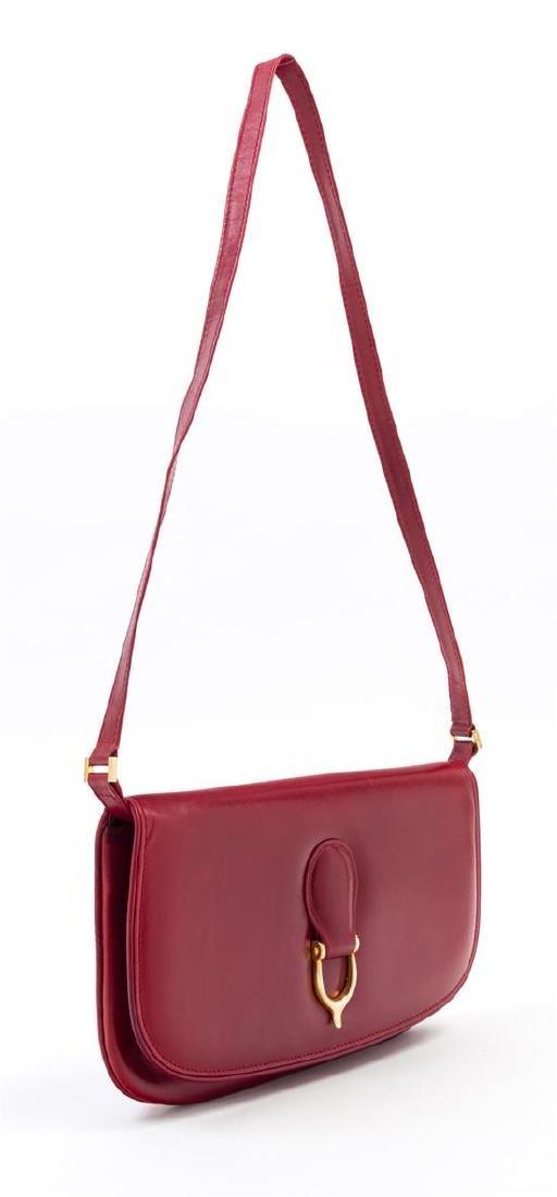 "A Gucci Red Leather Flap Handbag, 10.5: x 7"" x 1""; - 2"