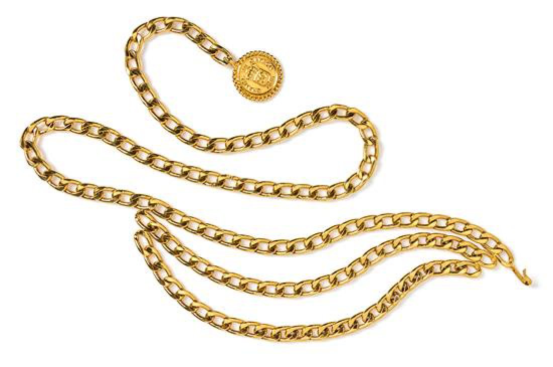 "A Chanel Goldtone Chain Belt, Length: 35.5""; Drop: 3""."