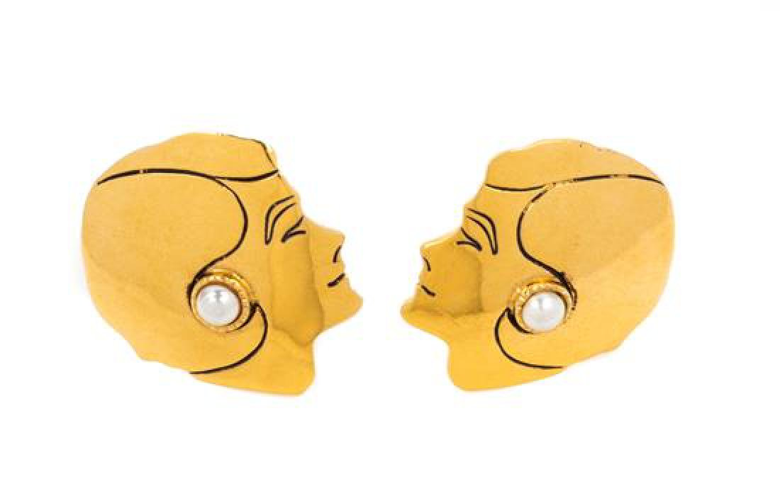 """* A Pair of Chanel Goldtone Face Earclips, 1.25"""" x 2""""."""