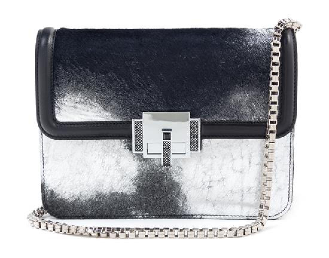 * A Judith Leiber Black and Silver Leather and Calf