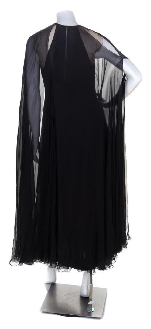 * A Black Silk Sleeveless Layered Gown, No size. - 2