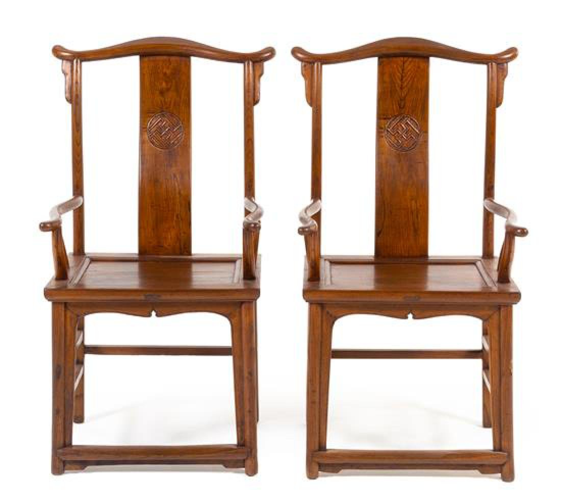 * A Pair of Chinese Elmwood Official's Hat Armchairs,