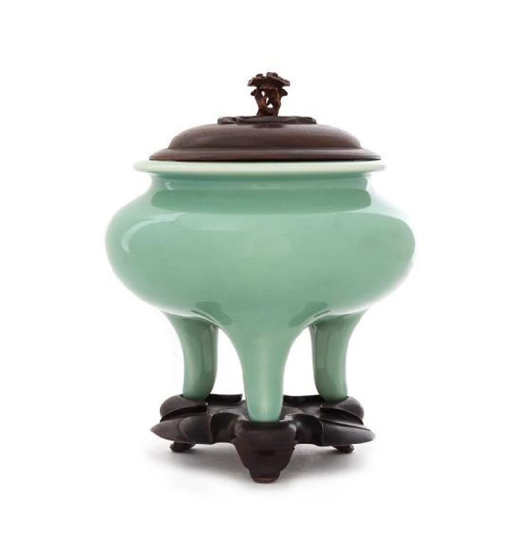 * A Japanese Celadon Glazed Porcelain Tripod Incense