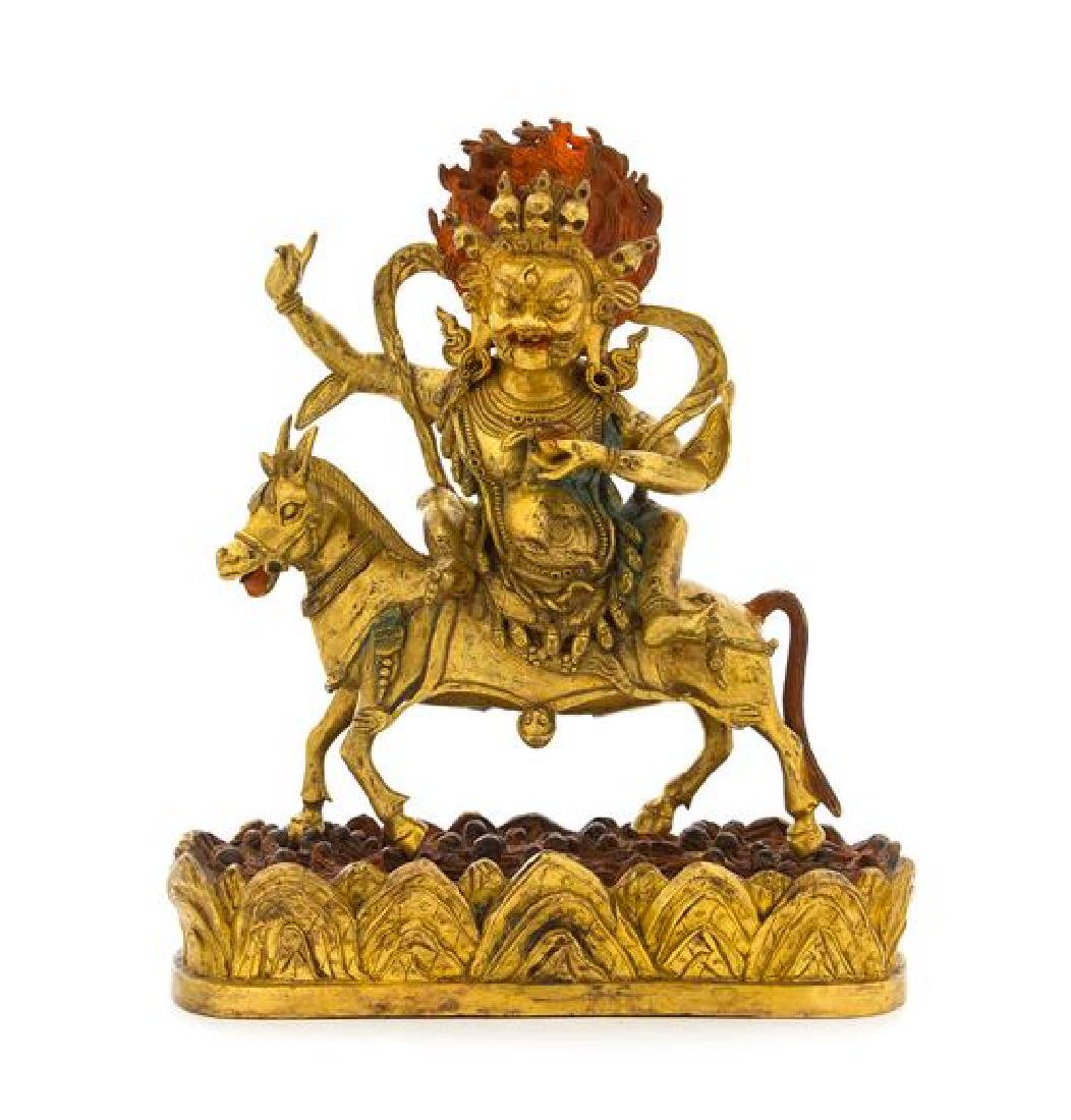 A Sino-Tibetan Gilt Bronze Figure of Magzor Gyalmo