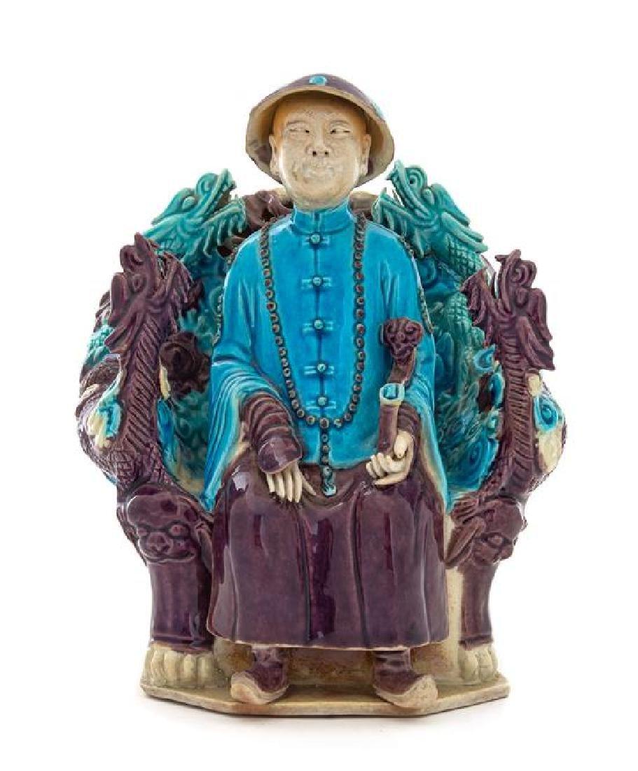 A Turquoise Aubergine Glazed Porcelain Figure of an